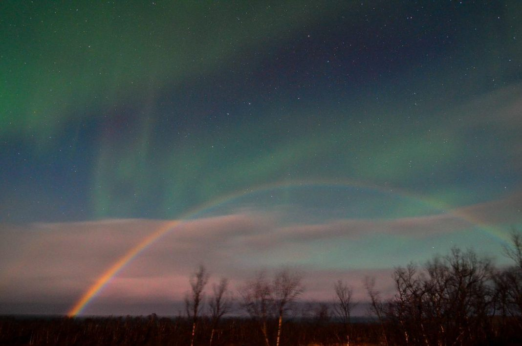 Super-Rare 'Moonbow' Photobombs Northern Lights Show Above Remote Swedish Town