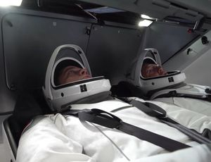 NASA astronauts check SpaceX spacesuits within the Crew Dragon