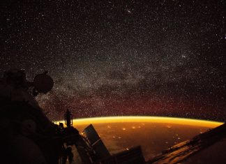 Ghostly Orange Light Envelopes Earth Throughout Rare Airglow