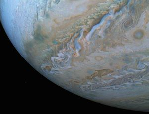 NASA catches cosmic 'dolphin' swimming in Jupiter's clouds