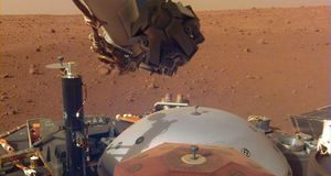 NASA InSight lander bends robotic arm, catches brand-new Mars views