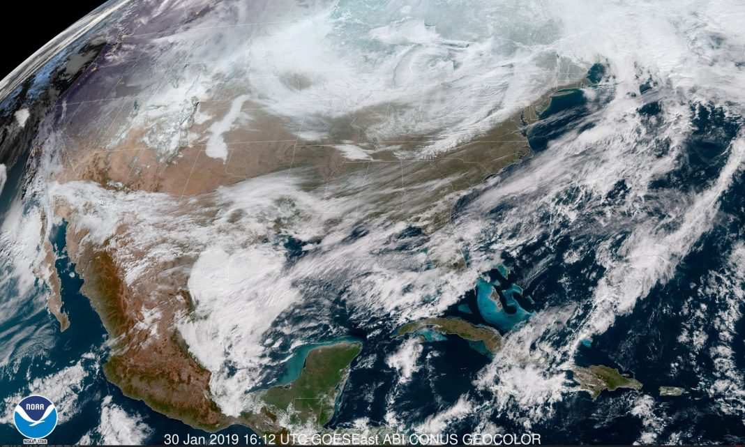 View the Polar Vortex Cast Its Chill Over The United States And Canada in This Satellite's- Eye View