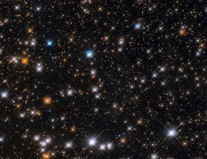 Hubble area telescope goes on cosmic duck hunt, shoots a cluster