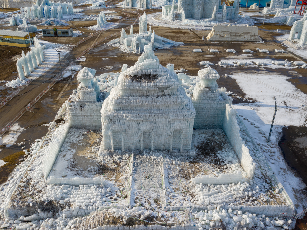 China's intricate winter season celebration is now a graveyard of melting ice castles. Have a look.