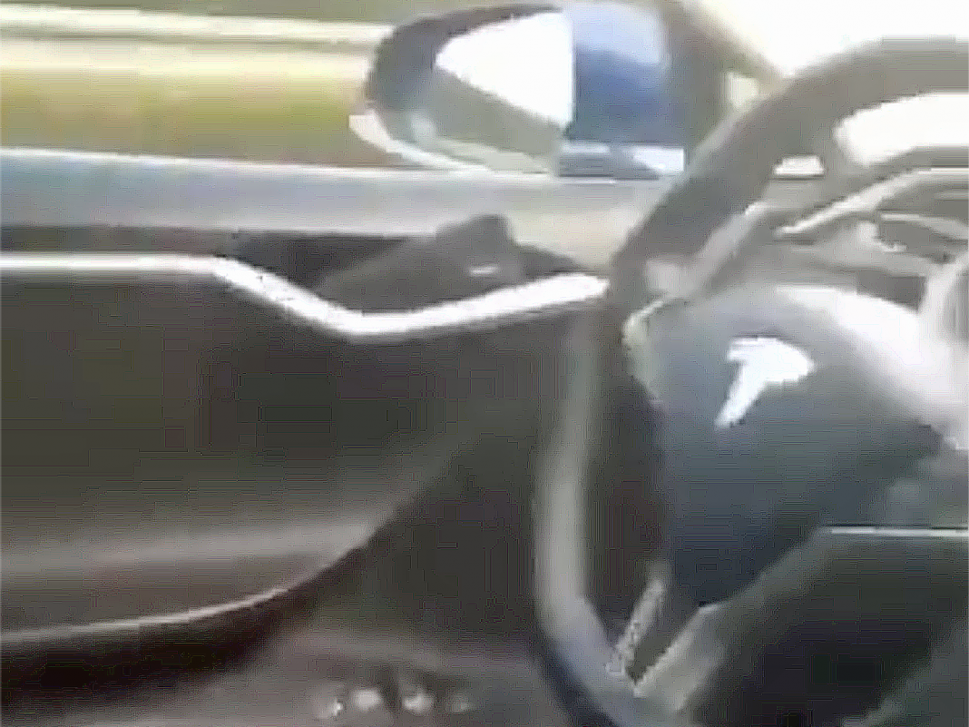 Video appears to reveal a Tesla Design S taking a trip on the roadway at speed without any one in the chauffeur's seat (TSLA)