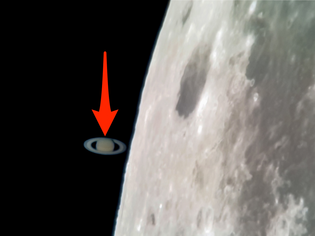 A professional photographer taped Saturn 'touching' the moon with his mobile phone, and the images are spectacular