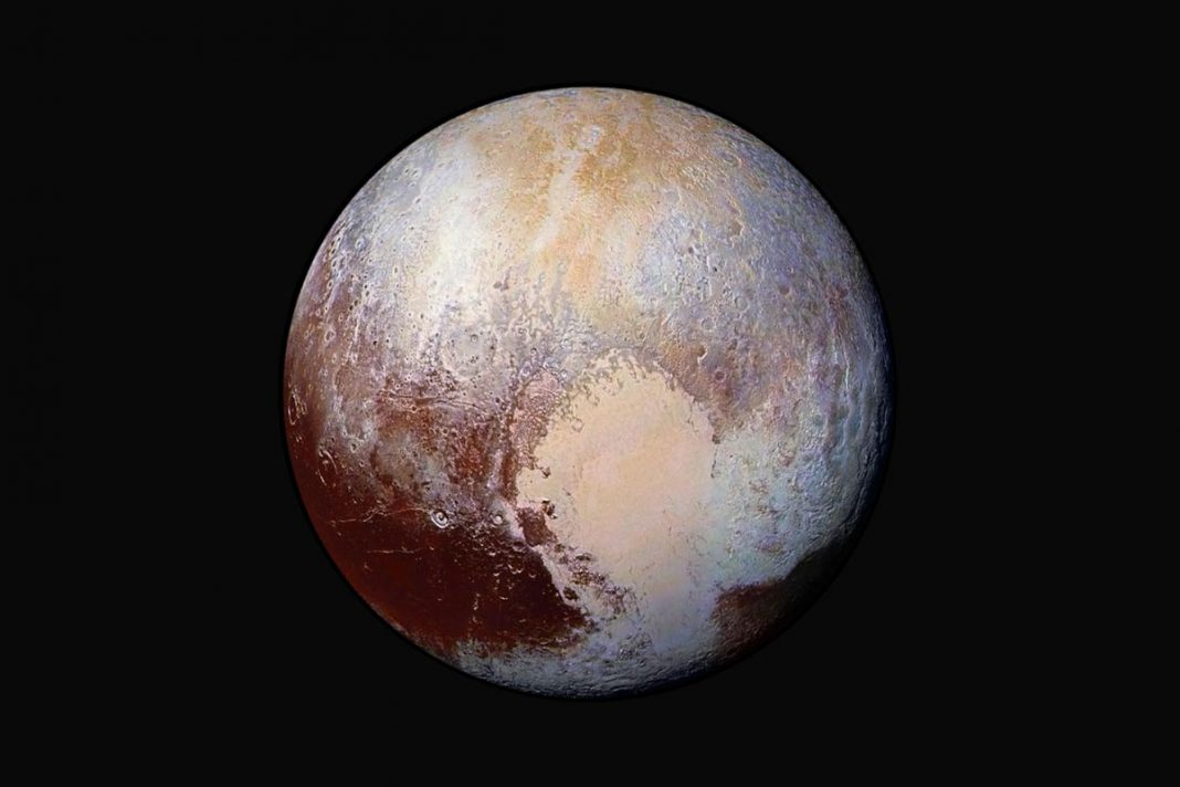 An Insulating Layer of Gas Might Keep a Liquid Ocean Inside Pluto