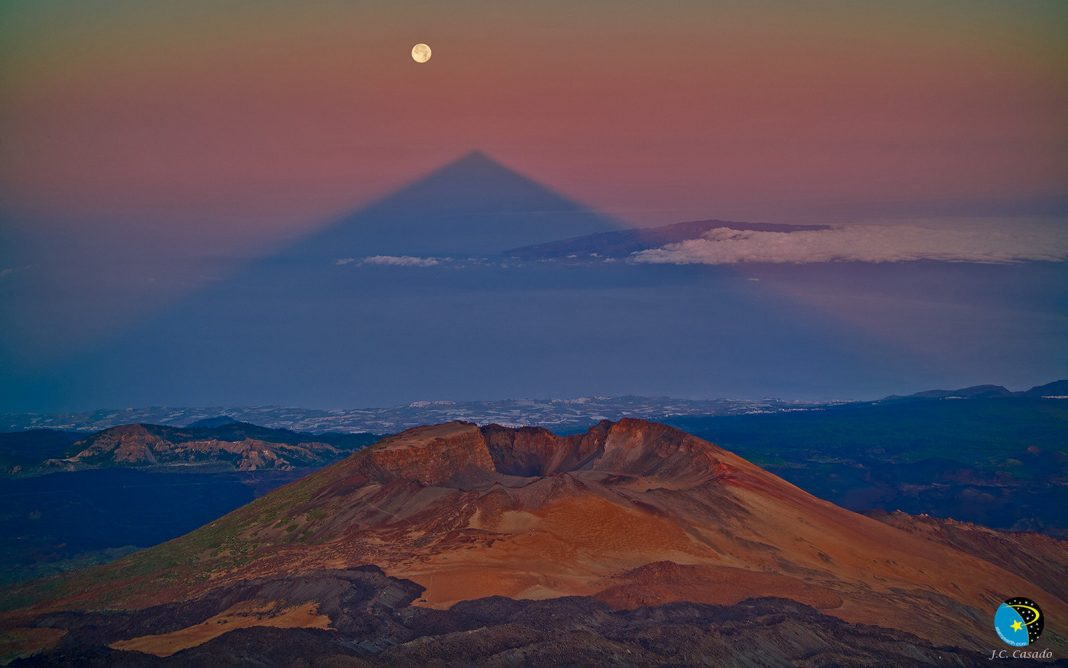 Volcano's Shadow Forms an Eerie, Perfect Triangle
