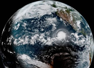 Satellite Image Catches an Overall Solar Eclipse and a Cyclone in One Amazing Shot