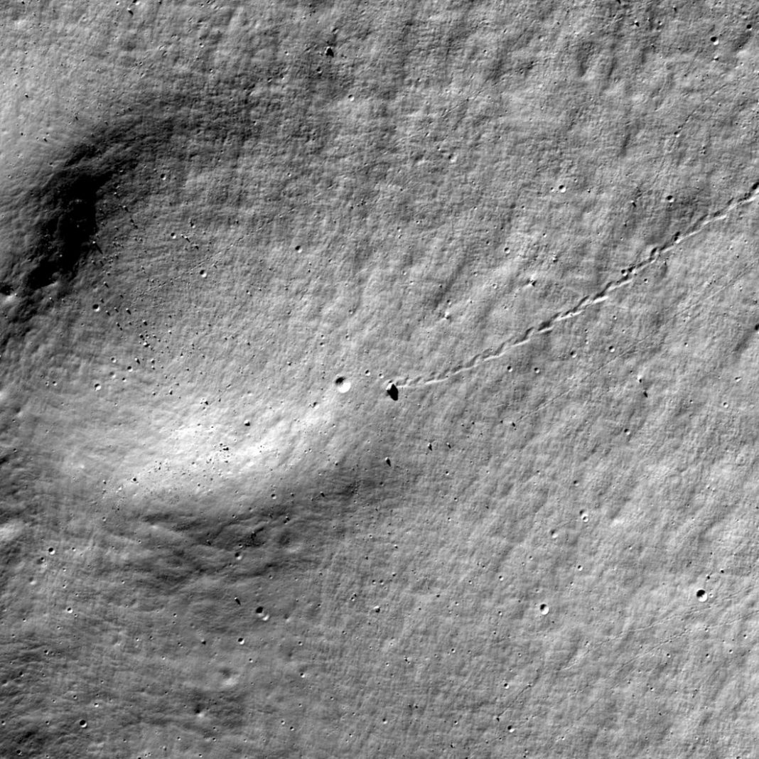 Rock Nearly Rolled Into This Crater on the Moon … Nearly