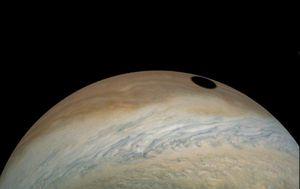 NASA Juno spacecraft areas moon shadow on Jupiter