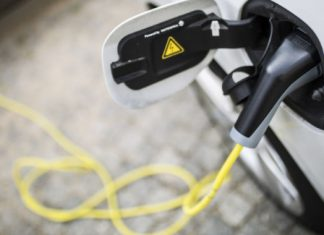 To replace gas taxes, Oregon and Utah ask EVs to pay for road use