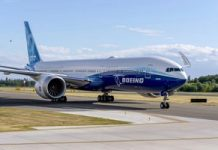 Boeing's new 777X extends its folding wingtips to complete first flight