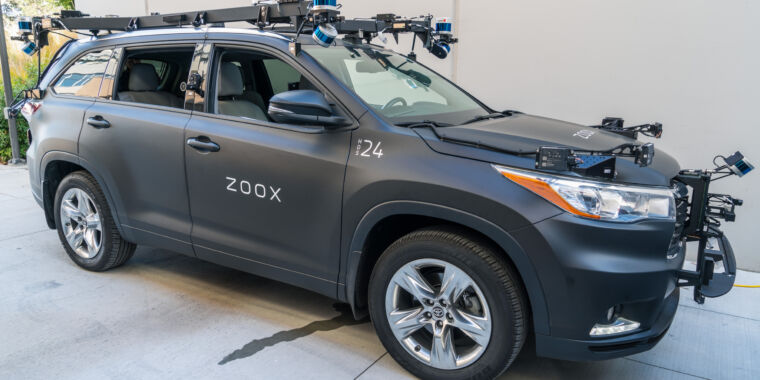Self-driving startup Zoox settles Tesla lawsuit, lays off 100 workers