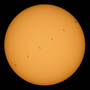 ISS looks like Star Wars TIE fighter as it crosses the sun in NASA image
