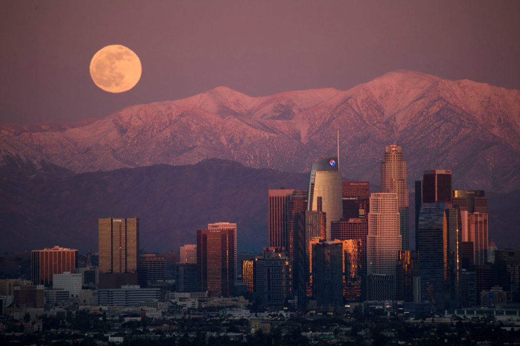 In Photos: The 'Cold Christmas Moon' Sparkles In Winter Skies Around The World