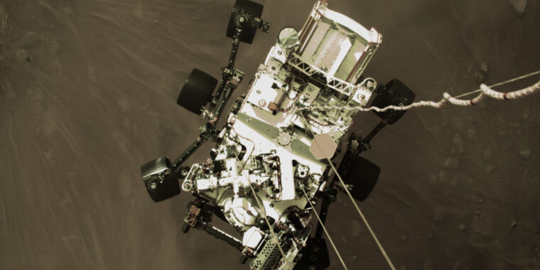 """NASA releases """"exhilarating"""" image of Mars rover just above the planet"""